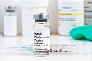 Women vaccinated with earlier versions of the human papillomavirus vaccine may only need cervical cancer screening every five years.