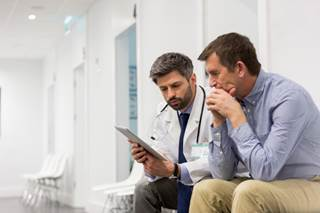 Younger men with prostate cancer are less likely to experience Gleason score upgrading and pathologic progression on repeat biopsy.